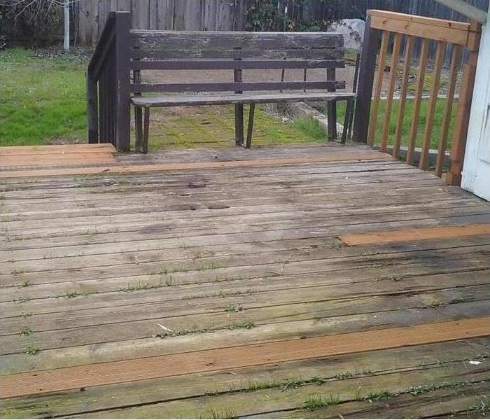 Outdoor storm damaged deck repaired