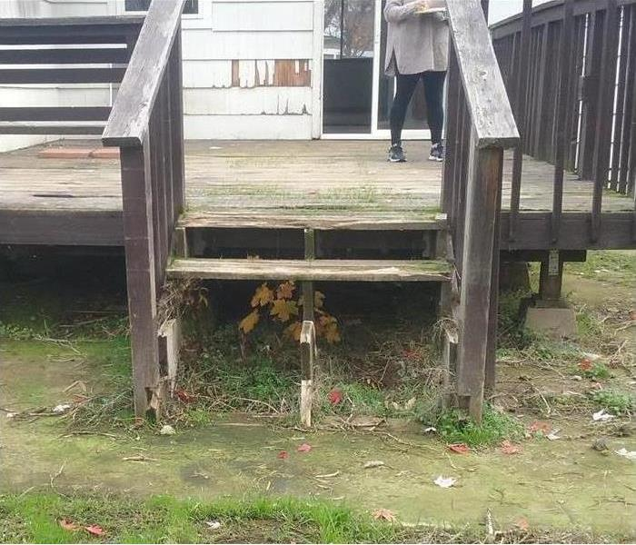 Storm damaged wood stairs steps missing