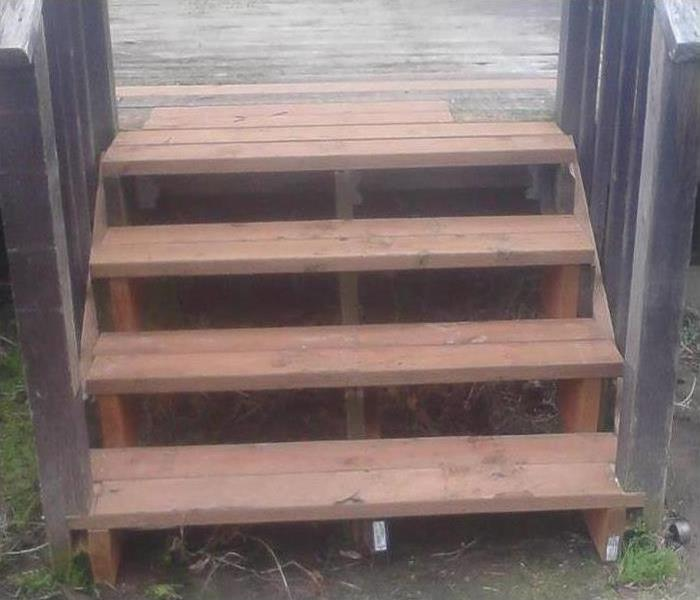 Storm damaged wood stairs steps replaced