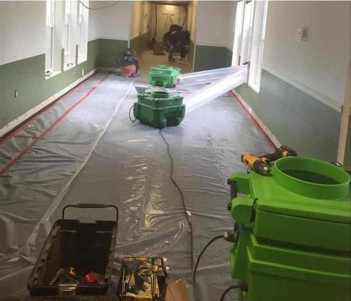 School hallway being dried out with dehumidifiers