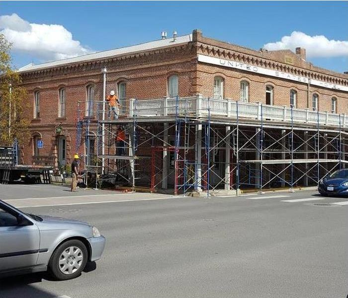 Vintage bank building with scaffolding set up around it