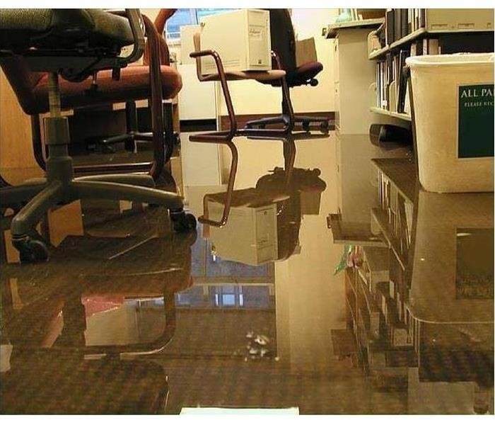 Office with carpeting flooded with water